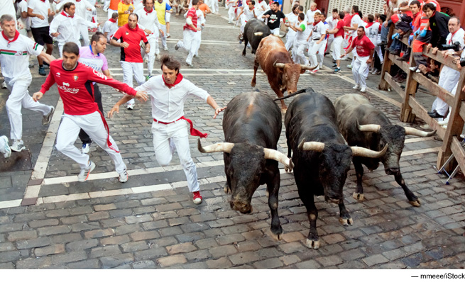 Photo of bulls running through Pamplona