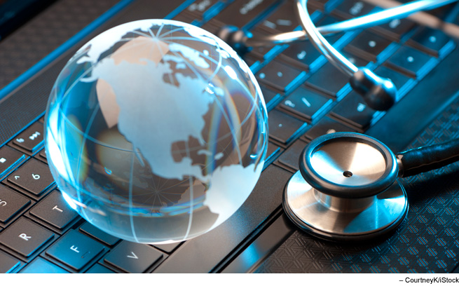 Stethoscope and glass globe on keyboard
