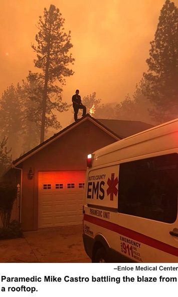 Paramedic Mike Castro battles flames from a rooftop