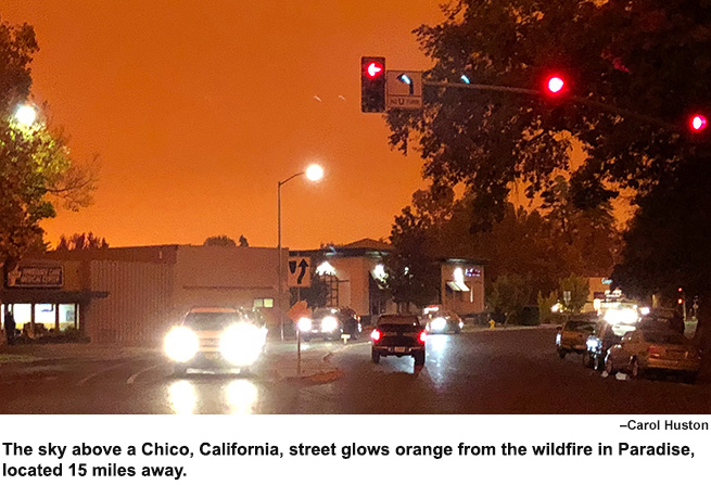 An orange glow from the Camp Fire over the streets in Chico.